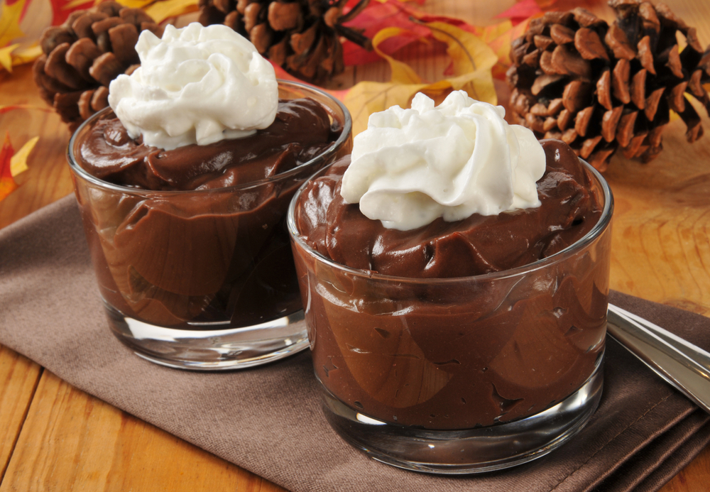 thanksgiving pudding with whipped cream on top